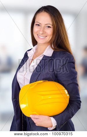 Young Female Architect Posing With Hard Hat