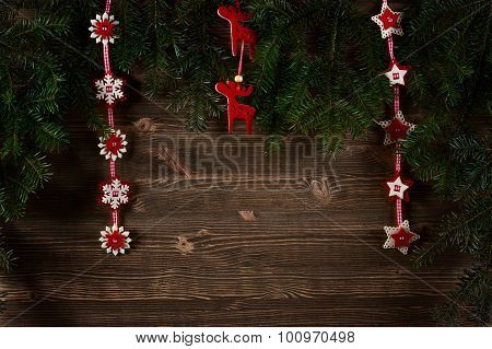 Old Planks Adorned With Christmas Tree Twigs And Decorations