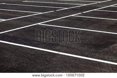 White Traffic Markings On A Gray Asphalt Parking Lot
