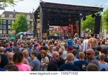 AMSTERDAM - AUGUST 2 2015: Unknown partying people during the Amsterdam Gay Pride a festive event with a gay cultural character. It is held annually since 1996 during the first weekend of August.