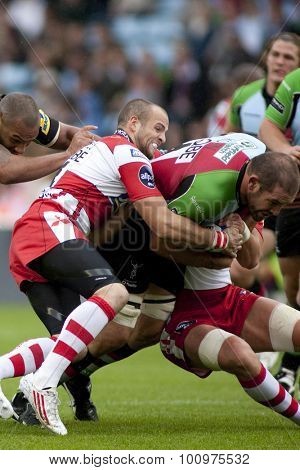 TWICKENHAM, ENGLAND. 17 SEPTEMBER 2011.  Gloucester's Charlie Sharples,  tackles Harlequins Ollie Kohn,  during the Aviva premiership rugby union match between Harlequins and Gloucester