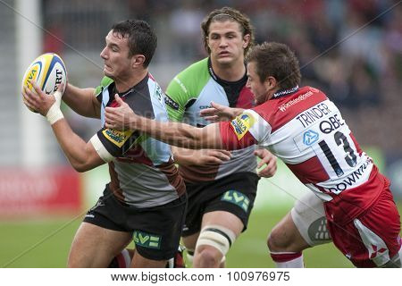TWICKENHAM, ENGLAND. 17 SEPTEMBER 2011. Harlequins George Lowe,  and Gloucester's Henry Trinder,  in action during the Aviva premiership rugby union match between Harlequins and Gloucester
