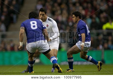 TWICKENHAM LONDON, 20 NOVEMBER 2010. Samoa's George Stowers, attempts to stop England's Shontayne Hape, during the International match between England and Samoa at Twickenham Stadium Middlesex England