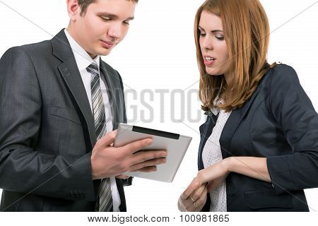Young officially dressed people having discussion with tablet