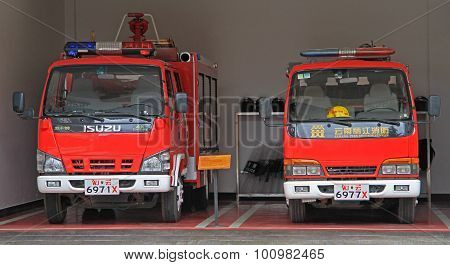 two fire engines in garage, Lijiang, China