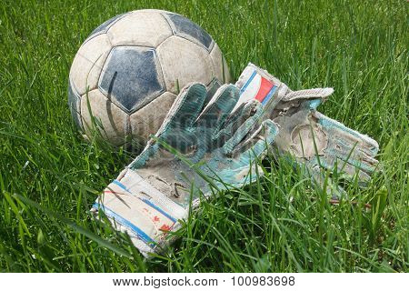 Soccer Ball And Goalkeeper Gloves On Grass