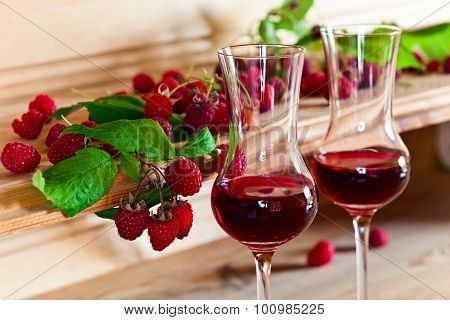 Raspberry Liqueur And Ripe Berries
