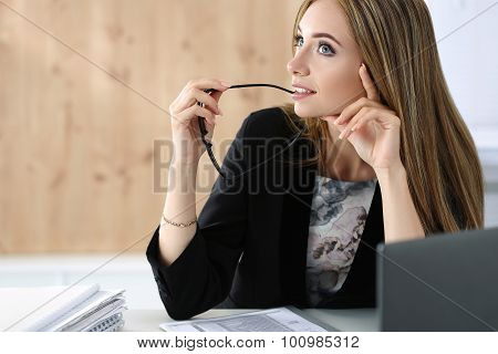 Young Beautiful Business Woman Sitting At Her Working Place