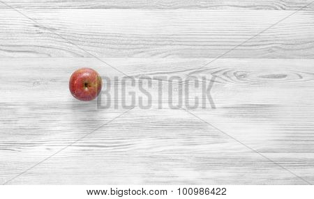 Red apple on black and white wood background
