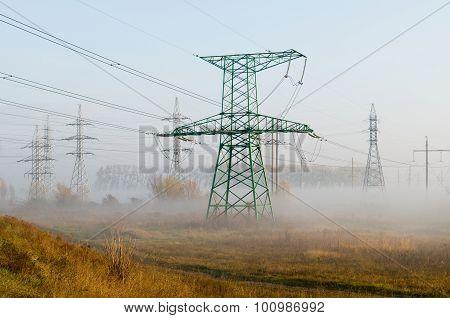 High-voltage Power Line Against Autumn Landscape