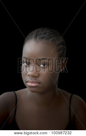 Low key portrait of an Afro girl, twelve years old