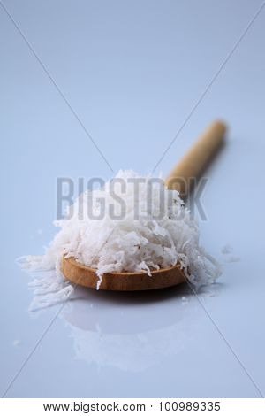 shredded coconut on the wooden spoon