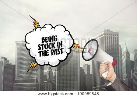 Being stuck in the past text on speech bubble and businessman hand holding megaphone