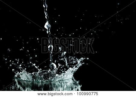 Water splash isolated on black background close-up