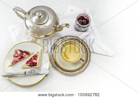 Breakfast With Tea, Sandwich And Jam On White Marble As A Corner Background