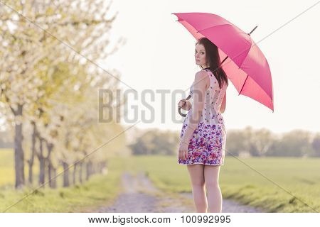 Beautiful Young Woman With Red Umbrella In Spring Or Summer