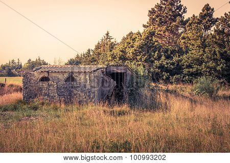 Small Brick House On A Field