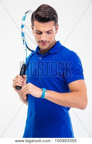 Portrait of a handsome male tennis player looking on fitness activity isolated on a white background