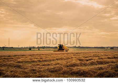 Harvester On Cropped Field