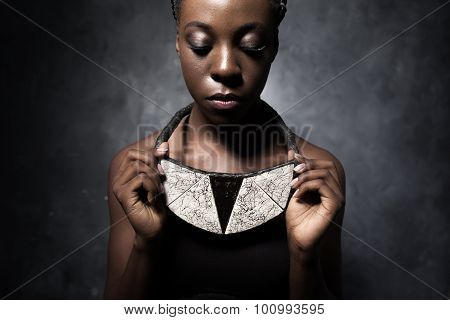African Woman Shows A Ceramic Ethnic Necklace