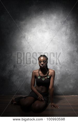 Beautiful Black Woman  Sits  On A Floor