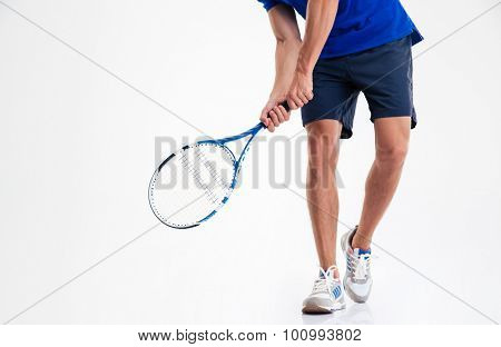 Closeup portrait of a male legs and tennis racket isolated on a white background