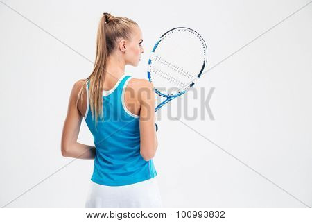 Back view portrait of a female tennis player standing isolated on a white background