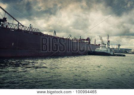 tugboat pushing a ship