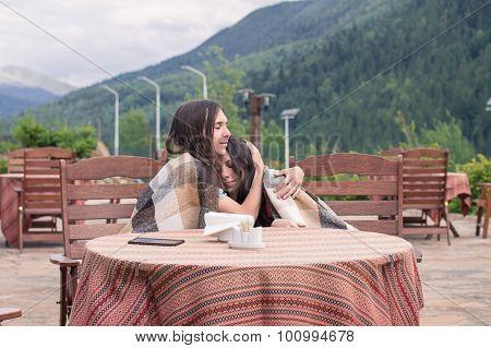Loving couple in Carpathian Mountains