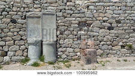 Stone wall and pillars