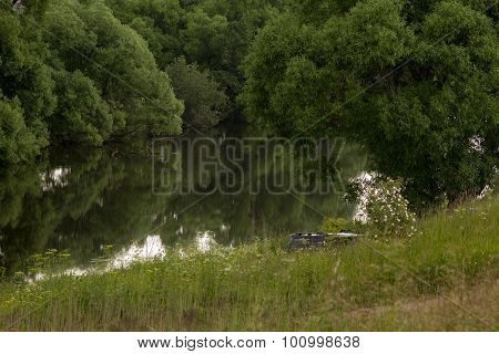 On The River Bank In The Impenetrable Thickets Is A Black Off-road Car