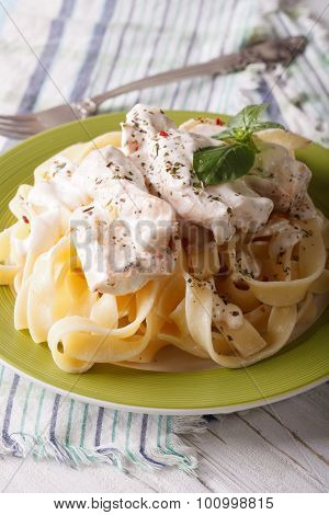 Pasta Alfredo With Chicken And Cream Sauce Close-up. Vertical