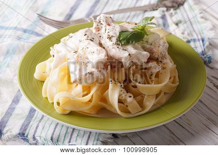 Fettuccine Pasta In Cream Sauce With Chicken Closeup. Horizontal