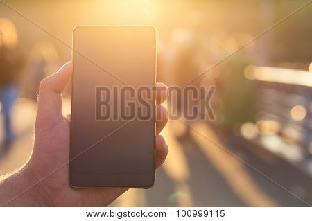 Man Using His Mobile Phone Outdoor