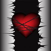 stock photo of broken heart  - Heart tied to a pole with spikes - JPG