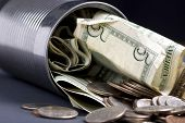 stock photo of save money  - a tin can is loaded with money - JPG