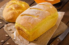 stock photo of fresh slice bread  - Fresh homemade pumpkin bread and pumpkin slices and olives - JPG