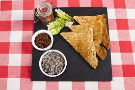 stock photo of canard  - Mushroom pate on a slate plate with pickle - JPG