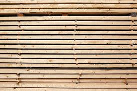 foto of lumber  - Stack of new wooden studs at the lumber yard as background - JPG