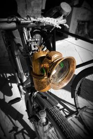 picture of dynamo  - Detail of an old Italian bicycle in black and white and colors with headlight and dynamo - JPG