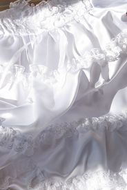 picture of baptism  - This is a close up of a white baptism dress laying down - JPG