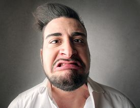 stock photo of snob  - Disgusted man - JPG