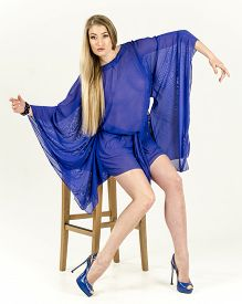 image of tunic  - A girl in a light blue cape transparent tunic and high heels - JPG