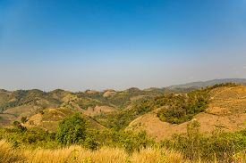 pic of denude  - Decimated deforestation mountains with the remnants of trees in northern part of Thailand - JPG