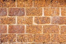 stock photo of pumice-stone  - stone wall made of volcanic pumice rock for background - JPG
