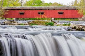 stock photo of cataracts  - Cataract Covered Bridge crosses Owen County Indiana - JPG