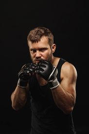 image of boxers  - Athletic bearded boxer with gloves isolated on a dark background - JPG
