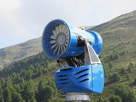 stock photo of cannon  - Snow cannon with mountains background in summertime  - JPG