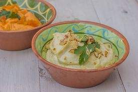 picture of humus  - White humus on a white wooden table - JPG