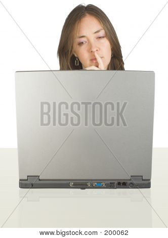 Business Woman On Her Desk With A Laptop